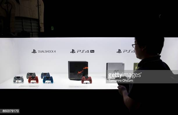 Visitor looks at PlayStation 4 video game consoles displayed in the Sony Interactive Entertainment Inc. Booth during the Tokyo Game Show 2017 at...
