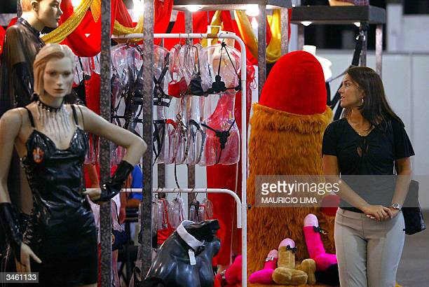 A visitor looks at products in a stand during Erotika Fair in Sao Paulo Brazil late 22 April 2004 The event the biggest of its kind in Latin America...