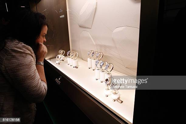 A visitor looks at Rolex watches at the Baselworld watch and jewellry Fair trade on March 17 2016 in Basel Switzerland Held annually Baselworld is...
