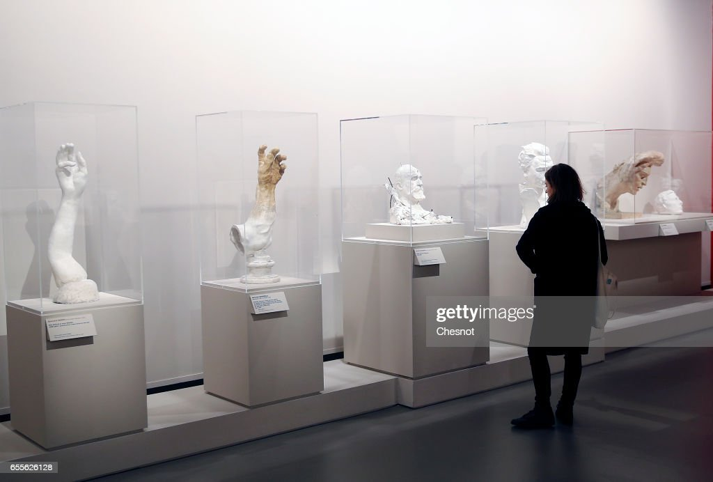 A visitor looks at sculptures by French sculptor Auguste Rodin (1840-1917) during the press preview 'Rodin the centennial exhibition' at the Grand-Palais on March 20, 2017 in Paris, France. To mark the centenary of his death, the Rodin museum and the Grand-Palais are joining forces to celebrate Auguste Rodin (1840-1917). This exhibition takes part from March 22 to July 31, 2017.