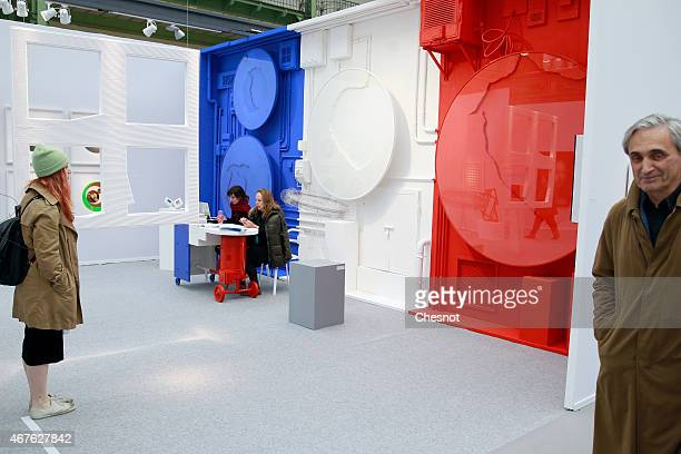 A visitor looks at sculptures by Venezulian artist Manuel Merida entitled 'medium blue cercle white circle and red cercle' during the 2015 Art Paris...