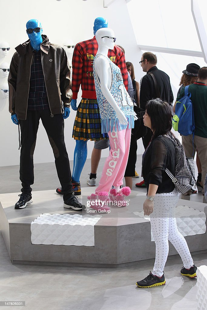 A visitor looks at the adidas Originals Spring/Summer 13 collection at the Bread and Butter 2012 fashion trade fair on July 4, 2012 in Berlin, Germany.