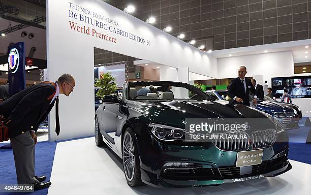A visitor looks at the Alpina B6 Biturbo Cabrio Edition 50 after the vehicle's debut during the Tokyo Motor Show in Tokyo on October 28 2015 AFP...