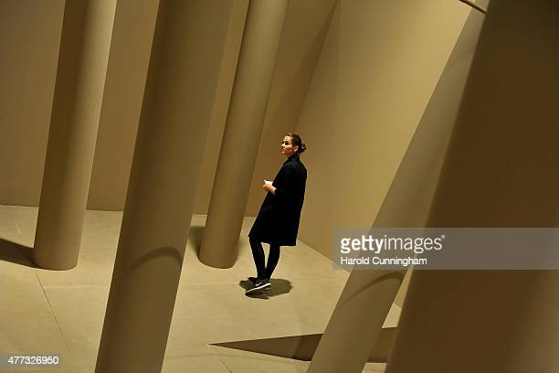 A visitor looks at the artwork 'Architettura cacogoniometrica Ambiente' by Gianni Colombo during Art Basel on June 16 2015 in Basel Switzerland Art...