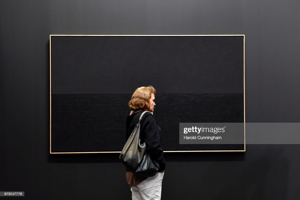 A visitor looks at the artwork of Alberto Burri 'Nero Collotex' during the press preview for Art Basel at Basel Messe on June 13, 2018 in Basel, Switzerland. Art Basel is one of the most prestigious art fair in the world showcasing the work of more than 4,000 artists selected by 300 leading art galleries.