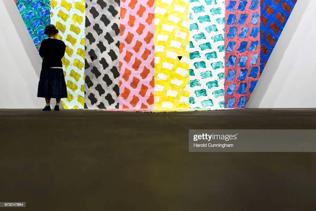 A visitor looks at the artwork of Claude Viallat 'Untitled' during the press preview for Art Basel at Basel Messe on June 13, 2018 in Basel, Switzerland. Art Basel is one of the most prestigious art fair in the world showcasing the work of more than 4,000 artists selected by 300 leading art galleries.