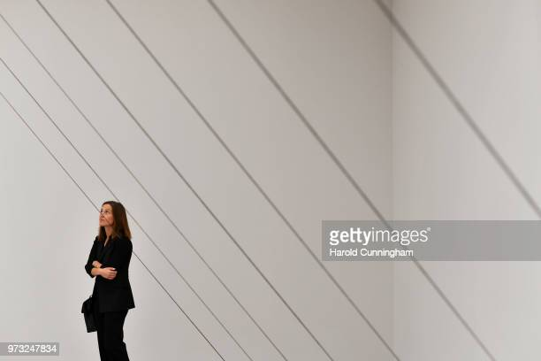 A visitor looks at the artwork of Fred Sandback 'Untitled' during the press preview for Art Basel at Basel Messe on June 13 2018 in Basel Switzerland...