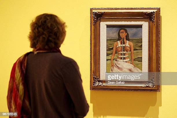 A visitor looks at The Broken Column by Mexican painter Frida Kahlo at the Frida Kahlo Retrospective at MartinGropiusBau on April 29 2010 in Berlin...