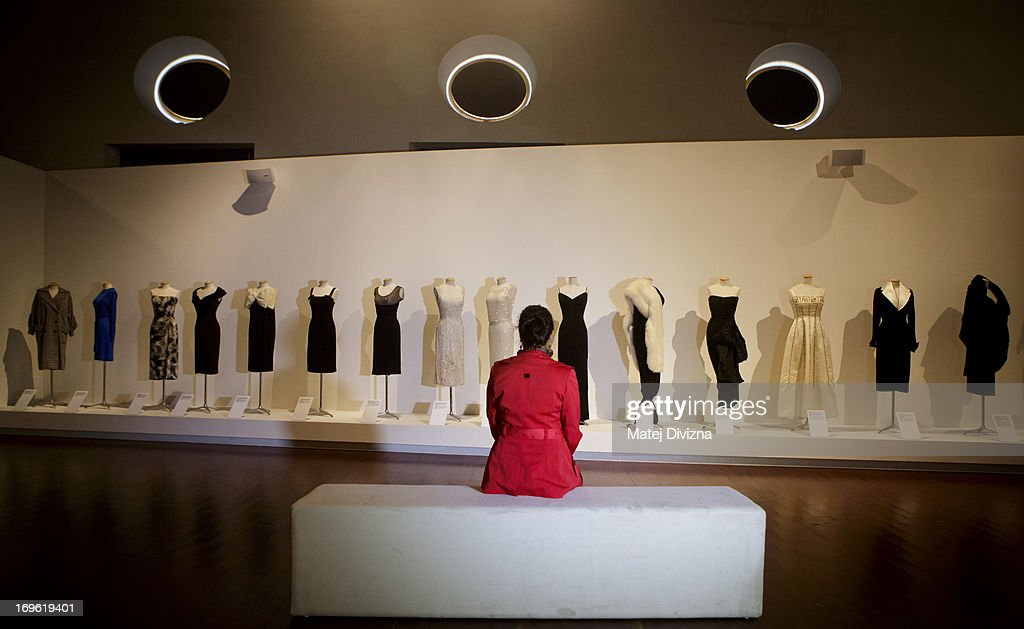A visitor looks at the evening dresses collection during a press preview of the 'Marilyn' exhibition at Prague Castle on May 29, 2013 in Prague, Czech Republic. The exhibition was created by the Museo Salvatore Ferragamo in Florence, in 2012. Marilyn Monroe loved and owned many pairs of shoes made by Ferragamo. The Marilyn exhibition, which commemorates the 50th anniversary of her death, runs at the Riding School until September 20, 2013. The exhibition will present 30 pairs of shoes and over 50 outfits and other accessories from Marylin's personal, public and movie wardrobe and also historical movie clips, magazine covers and Marilyn's original writings.