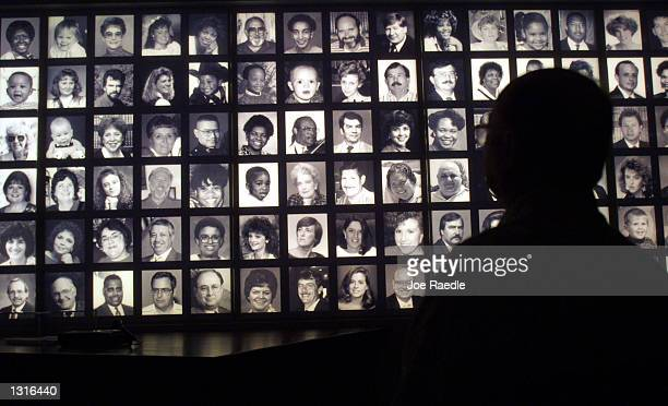 A visitor looks at the faces of some of the victims of the Oklahoma City bombing at the Oklahoma National Memorial museum in Oklahoma City June 12...