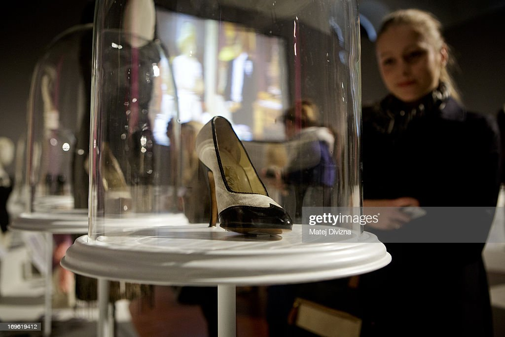 A visitor looks at the high heel shoe designed by Ferragamo from the film 'Some like it hot', during a press preview of the 'Marilyn' exhibition at Prague Castle on May 29, 2013 in Prague, Czech Republic. The exhibition was created by the Museo Salvatore Ferragamo in Florence, in 2012. Marilyn Monroe loved and owned many pairs of shoes made by Ferragamo. The Marilyn exhibition, which commemorates the 50th anniversary of her death, runs at the Riding School until September 20, 2013. The exhibition will present 30 pairs of shoes and over 50 outfits and other accessories from Marylin's personal, public and movie wardrobe and also historical movie clips, magazine covers and Marilyn's original writings.