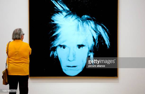 A visitor looks at the image 'Self portrait ' by Andy Warhol at the Brandhorst Museum in Munich Germany 22 June 2015 The exhibition YES YES YES...