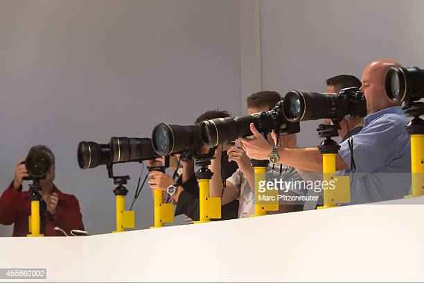 Visitor looks at the latest Nikon digital cameras at the 2014 Photokina trade fair on September 21 2014 in Cologne Germany Photokina is the world's...