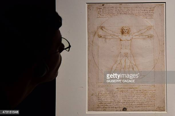 A visitor looks at the Leonardo's piece 'Vitruvian Man' presented at the Palazzo Reale museum as part of the exhibition 'Leonardo Da Vinci' on May 13...