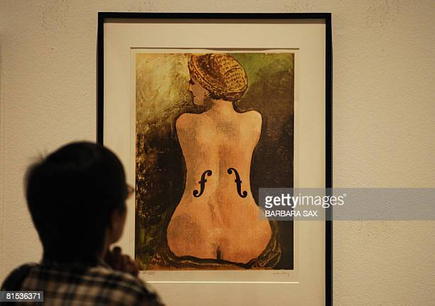 """Visitor looks at the lithograph titled """"Le Violon d'Ingres, 1924 """" by US artist Man Ray on June 12, 2008 at the Martin-Gropius-Bau museum in Berlin...."""