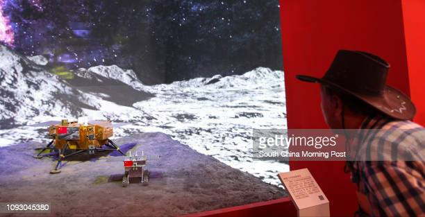 A visitor looks at the model of Chang'e3 lunar lander at a special exhibition celebrating the achievements in the past five years since the 18th...