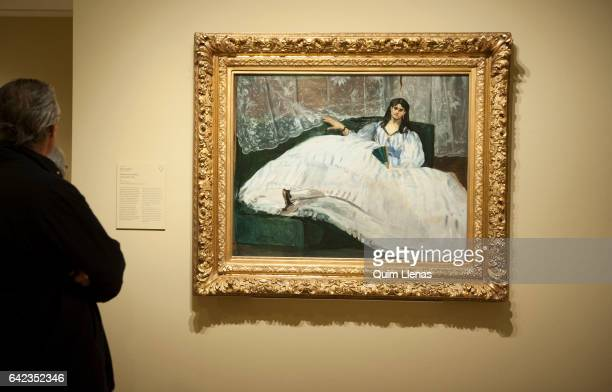 A visitor looks at the paint 'Dama con un abanico' by Edouard Manet during the press preview of the exhibition 'Obras maestras de Budapest' at...