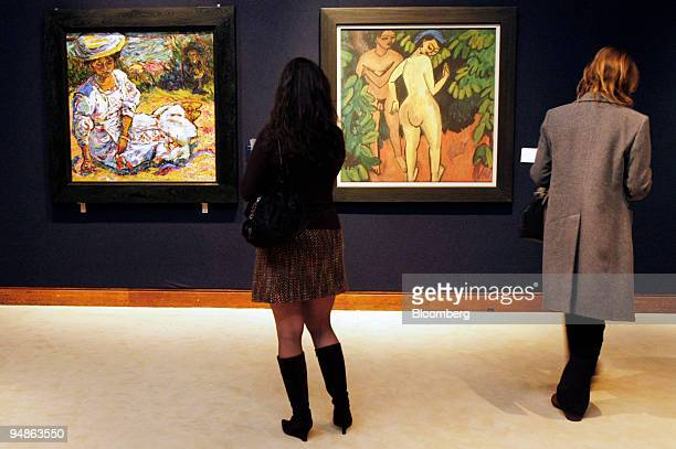 A visitor looks at the painting 'Adam and Eve' left by Ernst Ludwig Kirchner for a Christie's auction in London England Friday February 3 2006