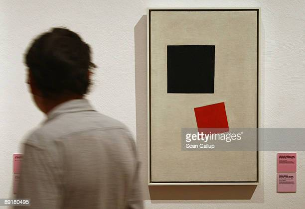A visitor looks at the painting Boy with Knapscak Color Masses In The Fourth Dimension by Kazimir Malevich at the modell bauhaus exhibition on the...