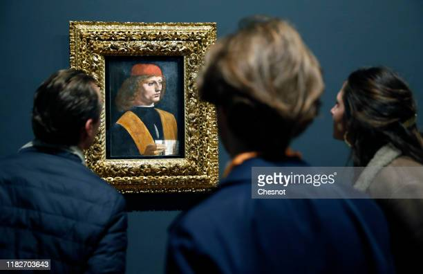 Visitor looks at the painting entitled 'Portrait of a young man with a music sheet, aka The Musician' by the Italian Renaissance artist, Leonardo da...