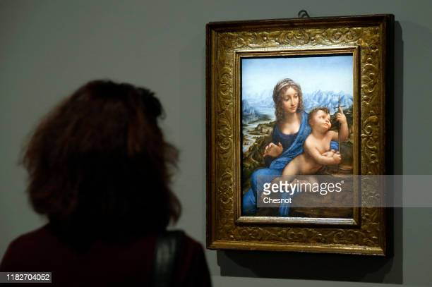 Visitor looks at the painting entitled 'The Virgin and the child' by the Italian Renaissance artist, Leonardo da Vinci, during a press visit of the...