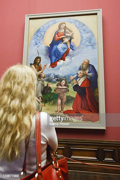 Visitor looks at the painting 'Madonna Di Foligno' at the opening of the exhibition 'Himmlischer Glanz' with Raffaelo 'Raffael' Santi's paintings...