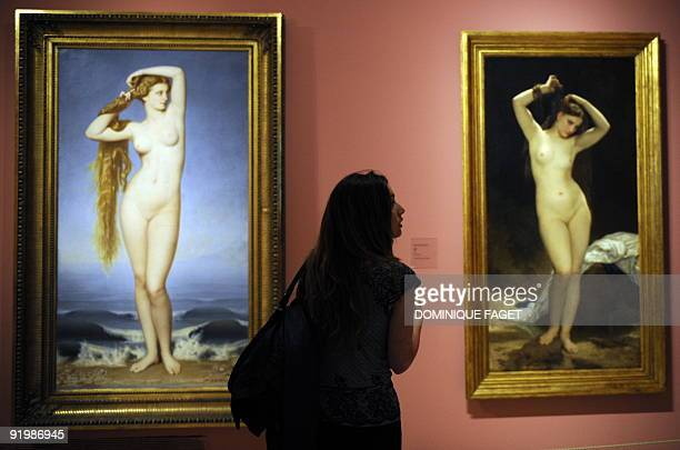 A visitor looks at the painting 'The birth of Venus' by Eugene Emmanuel AmauryDuval and 'Bather' of William Adolphe Bouguereau during the opening of...