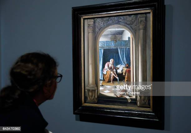 A visitor looks at the painting 'Woman with her toilet' by Dutch painter Ian Steen 16261679 during a press visit of the exhibition 'Vermeer and the...