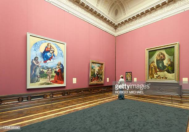 "Visitor looks at the paintings ""Sixtinische Madonna"" and the ""Madonna di Foligno"", wich are closely related, by Italian artist Raphael and displayed..."