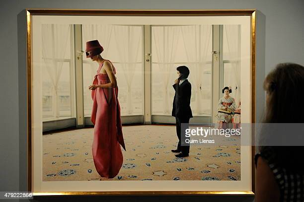 A visitor looks at the photograph titled 'Carmen in Kyoto no 4' by Yelena Yemchuk during the opening for the press of 'Vogue like a painting'...