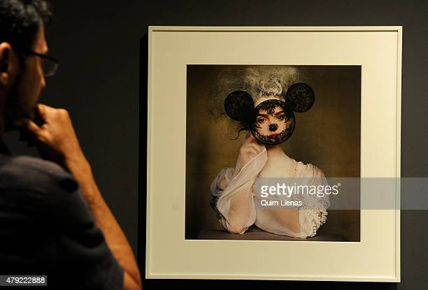 A visitor looks at the photograph titled 'Ives Saint Laurent Blouse New York' by Irving Penn during the opening for the press of 'Vogue like a...