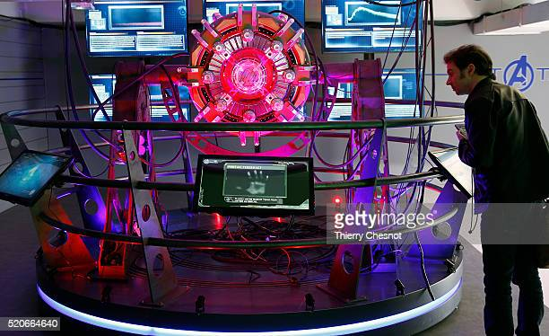 A visitor looks at the 'portail Tesseract' during the 'Marvel Avengers STATION' exhibition at La Defense on April 12 2016 in Paris France The...
