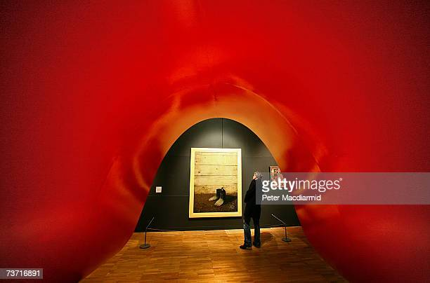 A visitor looks at The Red Model III by Rene Magritte in the Surreal Things Exhibition at the VA Museum on March 27 2007 in London The Surreal Things...