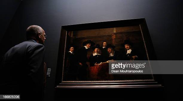 A visitor looks at The Sampling Officials also called Syndics of the Drapers' Guild is a 1662 oil painting by Rembrandt four days after the...