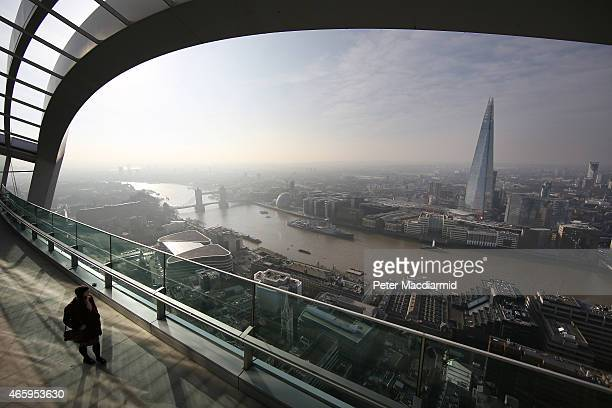 A visitor looks at the view from the Sky Garden terrace at 20 Fenchurch Street on March 12 2015 in London England Number 20 Fenchurch Street is...