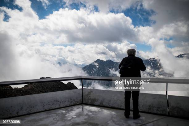 A visitor looks at the view on July 11 2018 on the terrace of the James Bond cinematic installation named '007 ELEMENTS' at the top of the...