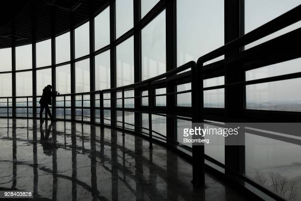 A visitor looks at the view towards the North Korean village of GaepungGun from the Odusan Unification Observatory near the Demilitarized Zone in...