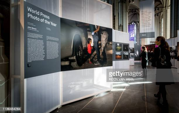 A visitor looks at the winning picture of photographer John Moore at the press opening of the World Press Photo exhibition in De Nieuwe Kerk...