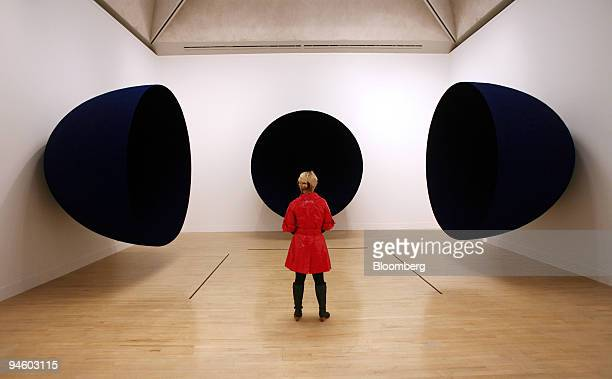 A visitor looks at the work by Anish Kapoor an untitled piece dated 1990 at the Tate Britain in London UK on Monday Oct1 2007 The gallery is...