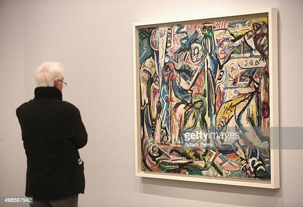 A visitor looks at the work 'Circumcision' 1946 by Jackson Pollock during a press preview of the 'Jackson Pollock's Mural Energy Made Visible'...