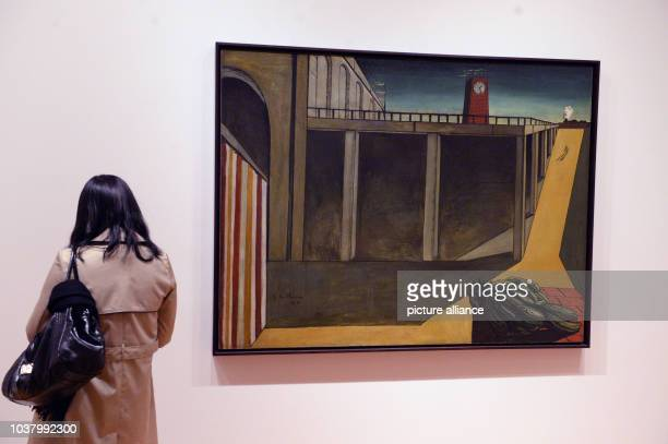 A visitor looks at the work 'Gare Montparnasse' by artist Giorgio de Chirico at the Museum of Modern Art in New York City USA 08 March 2014 Photo...