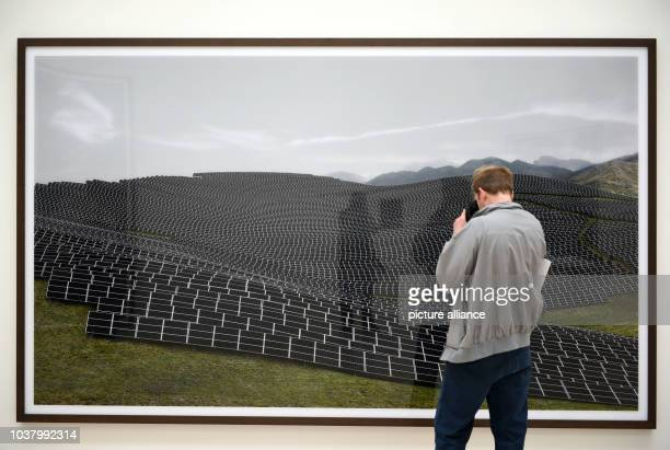 A visitor looks at the work 'Les Mees 2016' and during a preview at Kunstsammlung NordrheinWestfalen in Duesseldorf Germany 30 June 2016 The...