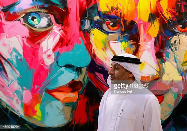 A visitor looks at the work of artist Francoise Nielly during World Art Dubai 2015 at Dubai World Trade Centre on April 9 2015 in Dubai United Arab...