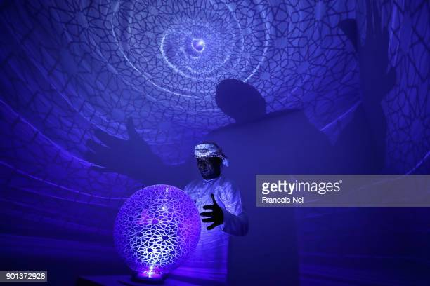 A visitor looks at the work of artist Najat Makki during Sharjah Islamic Arts Festival at Sharjah Art Museum on January 4 2018 in Sharjah United Arab...