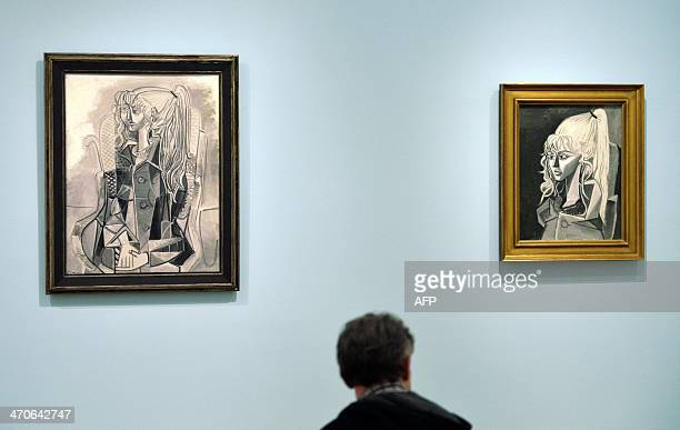 A visitor looks at the works both titled 'Sylvette' made on May 4 1954 and on May 3 1954 by Spanish artist Pablo Picasso during a preview of the show...