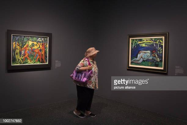 A visitor looks at the works 'Frieher Morgen' and 'Blauer Tag' by Max Pechstein during a press call at the Bucerius Kunst Forum in Hamburg Germany 17...