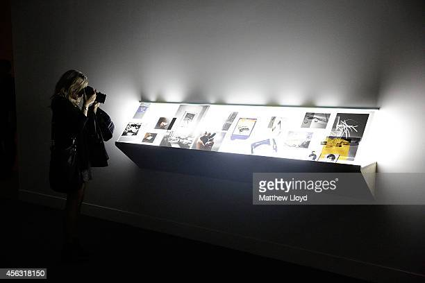 A visitor looks at Tris VonnaMichell's Addendum 1 Finding Chopin Dans L'Essex at Tate Britain on September 29 2014 in London England The installation...