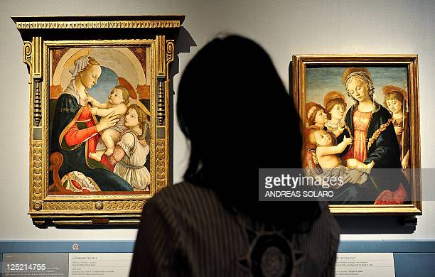 A visitor looks at 'Virgin and child with an Angel' and 'Madonna and Child two angels and the Young St John' by Italian Renaissance painter Sandro...