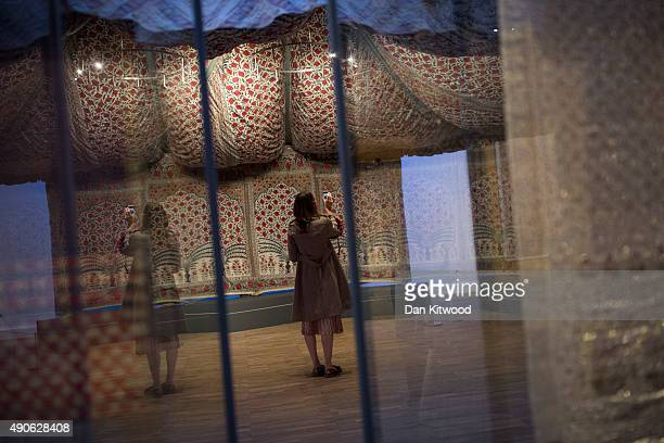 A visitor looks inside 'Tipu's Tent' during the press preview of 'The Fabric of India' at the Victoria and Albert Museum on September 30 2015 in...
