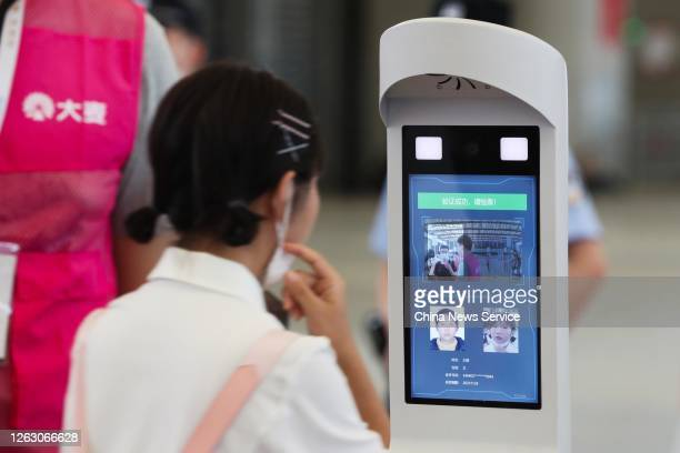 Visitor looks into a facial recognition device to enter Shanghai New International Expo Center during the 2020 China Digital Entertainment Expo &...